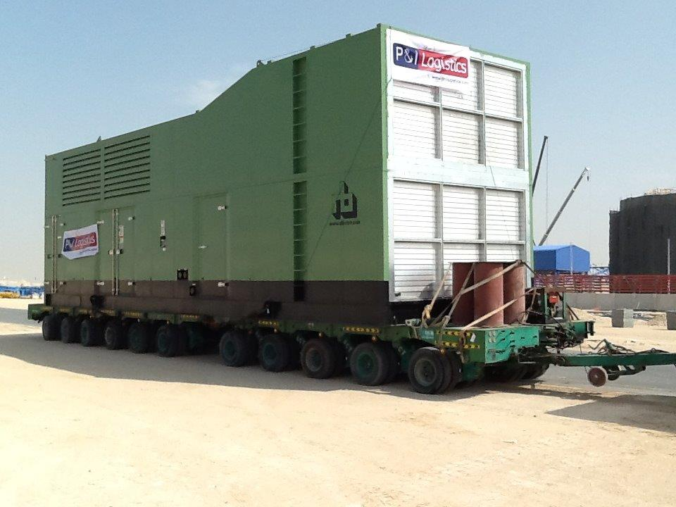 project logistics photo - 1 - Transportation of Generator sets from CAT (Al Bahar) yard using special trailer in Sharjah and delivery up to Abu Dhabi midfield airport site including offloading onto foundation
